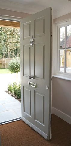 Traditional-style timber windows and doors from the Conservation™ range by Mum. - Traditional-style timber windows and doors from the Conservation™ range by Mumford & Wood have be - Front Door Porch, Grey Front Doors, Porch Doors, Front Door Entrance, House Front Door, House Entrance, Solid Wood Front Doors, Timber Front Door, Beautiful Front Doors