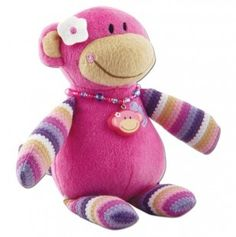 An adorable little pink happy monkey