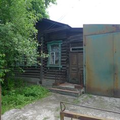 Steel garage and log cabin, Vyksa Russia