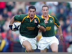 Springbok rugby players Joost van der Westhuizen and Stefan Terreblanche in a game against Scotland at Ellis Park.