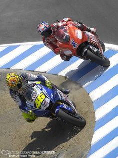 MotoGP 2008 - Laguna Seca Grand Prix at the Mazda Laguna Raceway track in California. Love this shot! Valentino Rossi passes Casey Stoner for the lead in the most famous and scary part of any racetrack in the world. ~ The Corkscrew. Amazingly awesome!!