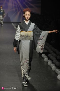 A piece from Jotaro Saito's fashion show — this is a houmongi, with motif at the hem and on one side of each sleeve, a semi-formal kimono.