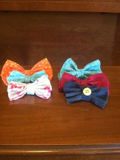 Cute D.I.Y hair bows!!! Just cut fabric into squares, accordion fold, and hot glue another piece of fabric around the middle! Add buttons or whatever you want. Every girl needs one of these!