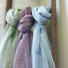 Herma Scarf from Creative Women Textiles. Accessorize with our gauzy cotton scarf accented by panels of thin white stripes. The perfect travel piece. Handspun and handwoven in Ethiopia.