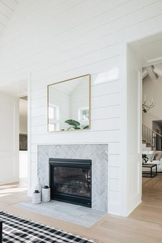 Cottage living room designed with a shiplap fireplace wall tiled with a gray chevron trim. Cottage living room designed with a shiplap fireplace wall tiled with a gray chevron trim. Tiled Fireplace Wall, Tile Around Fireplace, Fireplace Tile Surround, Bedroom Fireplace, Farmhouse Fireplace, Home Fireplace, Fireplace Remodel, Living Room With Fireplace, Fireplace Surrounds
