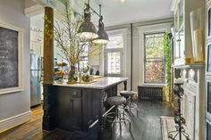 Absolutely love this eclectic New York Brownstone kitchen!