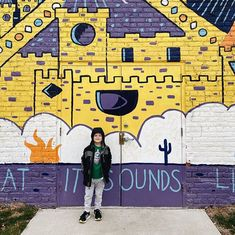 Happy to have at least one kid willing to stand in front of a random mural and smile for the camera