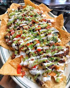 Carne asada nachos with taco cheese sauce avocado salsa pickled jalapeños black beans & Mexican crema. I Love Food, Good Food, Yummy Food, Tasty Meal, Cooking Recipes, Healthy Recipes, Skillet Recipes, Cooking Tools, Pizza Recipes