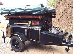 Custom steampunk trailer. Standard trailer convert into a 'steamy-pack' mobile. Customisation and leather work done at PAZ.