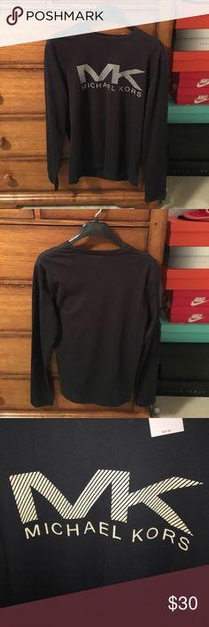 Michael Kors long sleeve t-shirt New Michael Kors long sleeve t-shirt. Color: black. Size: small. New with tags. 100% cotton. Happy poshing!!!😋✌️ Michael Kors Shirts Tees - Long Sleeve