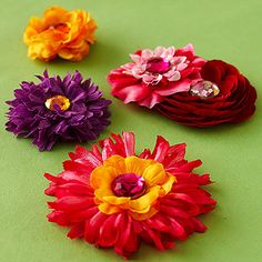 These beautiful hair clips can be large or small, depending on the flowers you select. Whatever size you choose, they're perfect accessories for a day spent frolicking in the summer sun.                 Make It: Select a contour hair clip smaller than your desired flowers and open it. Cut a 3-1/2-inch piece of 3/8-inch-wide grosgrain ribbon and add a light line of permanent fabric adhesive to one side. Wrap the ribbon around the clip's open top half only, ensuring that the clip can still…
