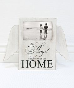Take a look at this White 'An Angel Watches Over Our Home' Winged Wall Sign today!