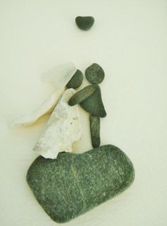 From my love for beachcombing, I create little bride and groom collages from the pebbles, shell bits and sea glass I find on the Kennebunk Beach in Maine. No two are alike. What you will receive is a