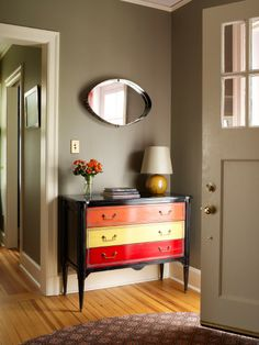 Fun idea for dressers - love how the wall color softens the bright colors on the dresser.
