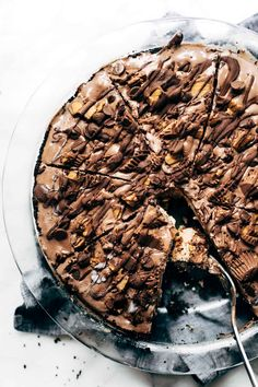 Mocha Peanut Butter Pie! A mocha cookie crust filled with creamy peanut butter cheesecake and topped off with chocolate ice cream and plenty of peanut butter cups. My new favorite dessert! #dessert #chocolate #peanutbutter #pie #nobake #sweettooth | pinchofyum.com