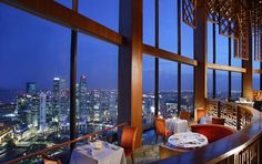 Dining with a breathtaking view in Singapore: Equinox Restaurant in the Swisshotel The Stamford Amazing views form the 70th floor. Food was superb as well. Just beautiful!