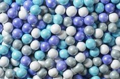 Princess Mix Sixlets Mini chocolate balls with a blue candy coating. Sixlets are in diameter. There are approximately 528 pieces per pound. Pair them with our Candy Beads or Shimmery Gumballs for a great addition to your candy buffet table! Chocolate Rocks, Chocolate Babies, Chocolate Covered Oreos, Melting Chocolate, Bubble Birthday Parties, Frozen Birthday Party, Candy Buffet Tables, Candy Table, Sixlets Candy