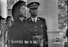 11/24/63: Jacqueline Kennedy waits on the White House North Portico to  follow the procession as JFK's casket is carried on a military caisson to the Capitol to lie in state in the Rotunda.