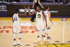 Draymond Green of the Golden State Warriors and Kevin Durant of the Golden State Warriors high five on the court during the game against the Los...