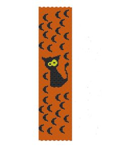 Black cat peyote pattern with asymmetric eyes surrounded for black moons, ideal for Halloween made black, yellow and orange seed beads,  the measurements for the Halloween cuff are (1.7in x 6.92in)