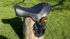 Custom leather motorcycle seat with two gun holsters & ammo belt....my husband made this! See Alamo Custom Leather on Facebook for more custom leather pieces!