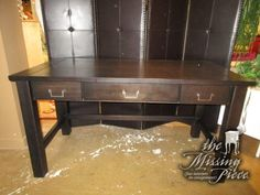 "Pier 1 writing desk in a dark espresso. Simple, clean lines! This desk has three drawers. Would be ideal in a bedroom or a smaller home office. Measures 60""long x 30""deep x 32""high. Arrived: Wednesday January 4th, 2017"