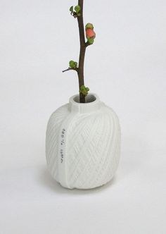 Mara Skujeniece--Spool vases; The series consists of Spool vases and necklaces. The ceramic form is created from a cast of a spool of thread.