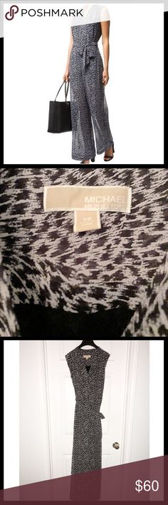 Michael Kors Wise Leg Animal Print Jumpsuit This is a Michael Kors animal print Jumpsuit, only worn once. Great condition, buttons down in the middle . Super cute paired with a leather jacket! Michael Kors Other