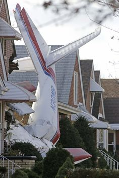 The wreckage of a small twin-engine cargo plane lies where the aircraft crashed into a home on Chicago's southwest side. The Aero Commander 500 had taken off from Midway International Airport and it slammed into the front of the home and plunged into the basement.