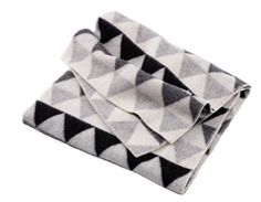 Designed by Chiqui Mattson for Klippan, the Patch Blanket in Grey