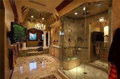 Traditional Master Bathroom with Chandelier, Corinthian column, can lights, Ms international - multi green onyx slab, Columns