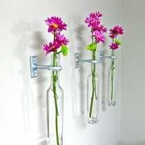 These recycled wine bottle vases can look pretty & traditional or edgy & modern, depending on hardware you choose. Recycled from Nashville's vineyards & rustic metal hardware compliments the cool shapes. Bottles easily come out of hardware to refill. 1 for $18 or 3 for $50.  greatbottlesoffire.com