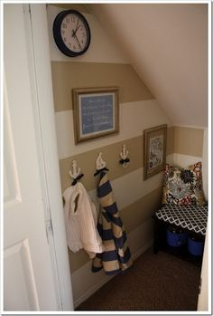 Under Stairs Coat Closet. Like the paint and the hook idea. Hooks on walls under  shelves. This is very