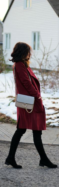 Winter style to keep warm: a long duster coat in this berry color paired with over the knee black boots and this Chloe look-alike bag (for less than $100!) By fashion blogger Marie's Bazaar
