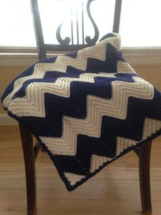 Finally finished my first afghan. Here's hoping the N family can get many snuggles with their soon-to-arrive little boy wrapped in it! {{For pattern, visit: http://www.eatknitanddiy.com/2013/03/chevron-baby-blanket-with-a-straight-edge/ }}