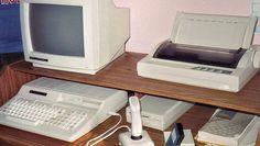 Tandy 1000 HX, with a Tandy RGB monitor, an external 5.25-inch disk drive, joystick, and a Tandy DMP-133 dot matrix printer.