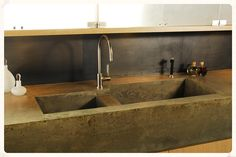 concrete in kitchen, concrete countertops, concrete sinks.