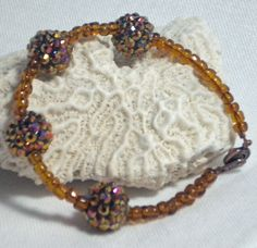 Copper Bling Ball Bracelet with Seed Beads by DesignsByJuneBug, $25.00
