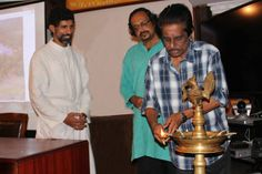 Director Harikumar lights the sacred lamp at the inauguration of the first FCCI film appreciation camp, June 2013, at Cochin