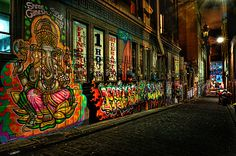 Our laneway by night. Love the colours against the dark of the night.