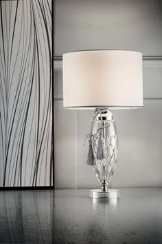 Contemporary classic table lamp with chromed metal stem and base, transparent blown glass base, cylindrical shade in white satin - Murano glass and crystal - Available on Vraiment Beau - We deliver worldwide - Référence: 20020141 Classic Lighting, Contemporary Classic, White Satin, Transparent, Murano Glass, Blown Glass, Classic Style, Wall Lights, Chandelier