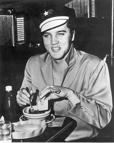"""Elvis at Katherine's Cafe in Oak Cliff, TX - Friday, October 12, 1956  """"On their way to Waco , the group left the Stoneleigh Hotel and found their way to Oak Cliff, a suburb of Dallas ... Elvis dropped into the Texas Army and Navy store, buying a 98 cent motorcycle cap. Elvis then found his way to Katherine's Cafe. He ordered a bowl of chili with frijoles and a soft drink."""" Stanley Oberst, Rockin Across Texas (FTD, 2005), page 165"""