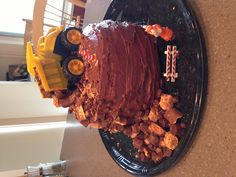 Dump truck birthday cake- my little boy second bday, will have to try something like this...
