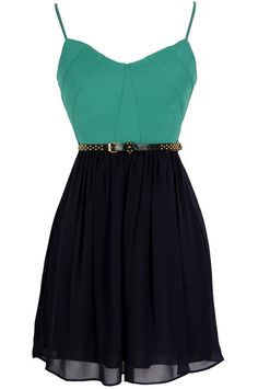 We love the unexpected pairing of green and navy together in this cheerful dress.  The Navy Pier Belted Green and Navy Dress is fully lined.  It has a sweetheart neckline and lined and lightly padded bust for support.  Adjustable spaghetti straps allow you to control the fit of this dress.  The top is made of a thick, substantial fabric and has bands of fabric pieces together in an intricate design.  The attached skirt is made of flowy chiffon in navy.  We love how pairing the bright green…