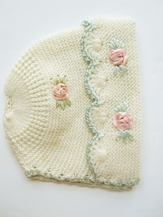 1930 A Soft Cream Knit Baby's Hat With Pink Satin