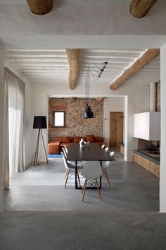 Concrete floors & wood beams living room #design