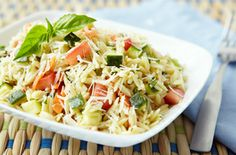 Orzo Garden Salad Recipe ~ Simple rice shaped pasta; crisp zucchini, carrots and celery mix with juicy tomatoes, fragrant herbs, Parmesan cheese and a light oil dressing. Raid your own veggie garden for fresh additions or substitutions.  ♥