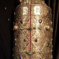 Hebrew Art, religious object : silver, gilded, wood, turquoises, glass paste, garnets, Afghanistan     Ornaments:description     A beautiful box for Torah scroll coming from the north part of Afghanistan (Akcha) : in the early 20th century a substantial Jewish community was still living in Afghanistan ... So far, there is not any Jew in Afghanistan... This ornated Thora box has a circumference of 96cm. Quite remarkable and for collectors only!      Weight:13kg    Height::25,19inch