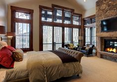 Contemporary Bedroom in Rustic Bedroom Design with Television Set above Fireplace