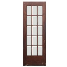 A fantastic antique reclaimed French door in oak, featuring 15 beveled glass lights on each door. The door is in very good antique condition with the